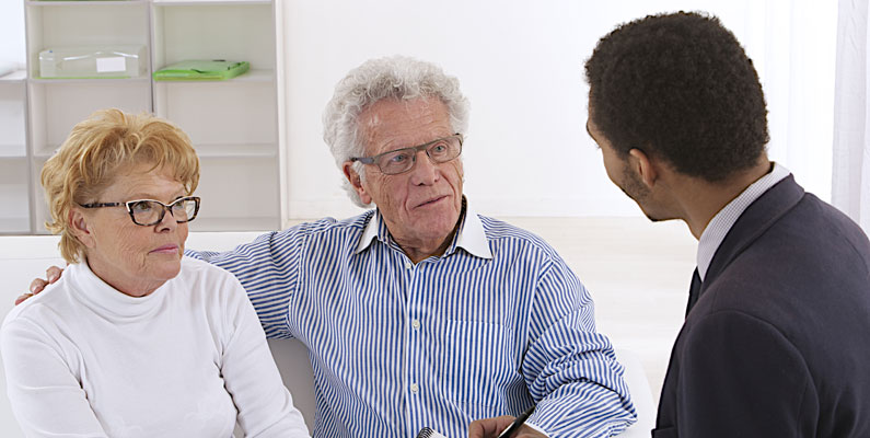 Retired Couple Discussing Financial Services